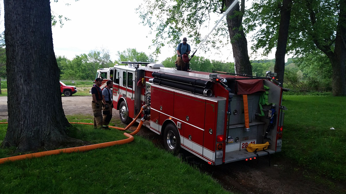 Engine 28-11 flows deck gun into French Creek at Wilson Shute boat ramp