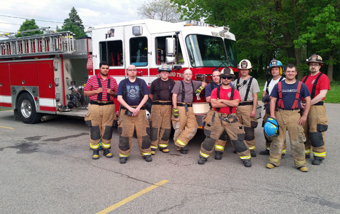 Firefighter crew with Engine 28-13 after training on preconnected attack lines