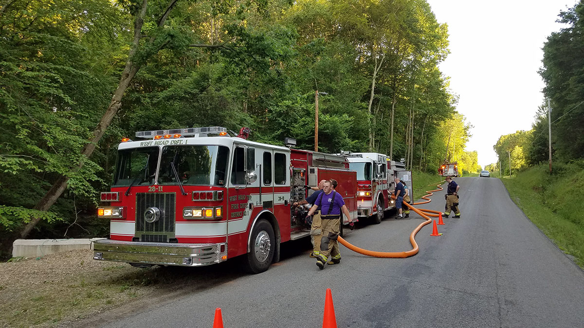 fire engines in a drafting and pumping relay drill on Townline Road