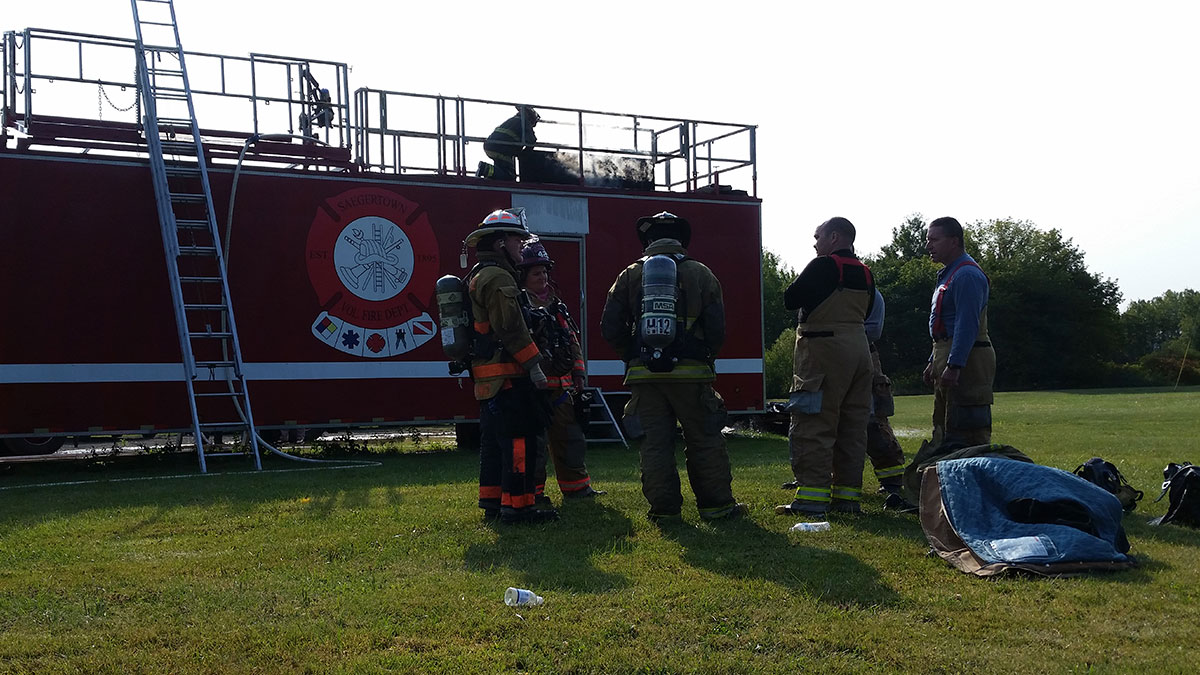 crew reviews training in burn trailer - MCI's & Basement Fires at Crawford Venango Fire School