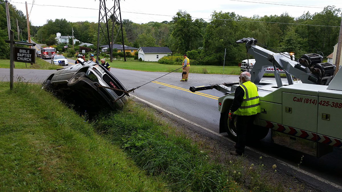 leonard towing pulls pickup from ditch - Barton Road Motor Vehicle Accident with Entrapment