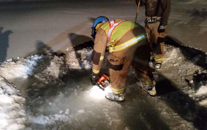 Nolan Jackson cuts access hole ice 700x441 - Home
