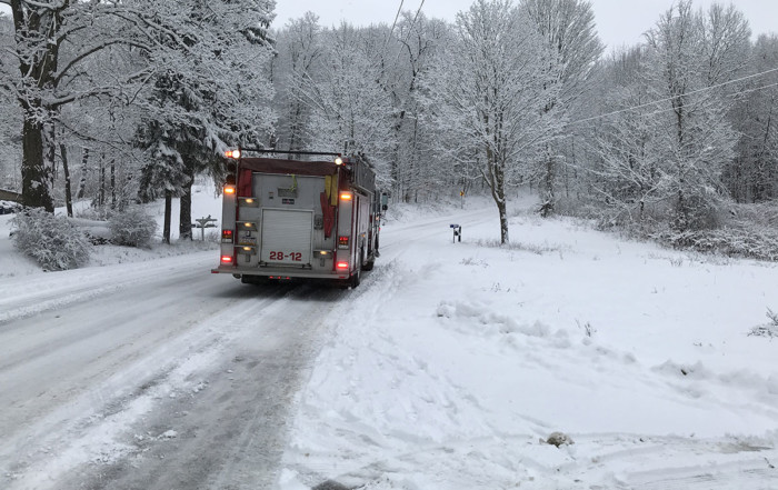Engine 28-12 providing traffic control on Pettis Road after a snowstorm