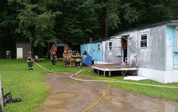 firefighters overhaul under trailer 700x441 - Home