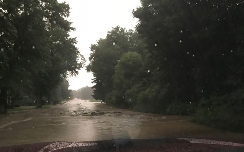 Water floods across Cochranton Road