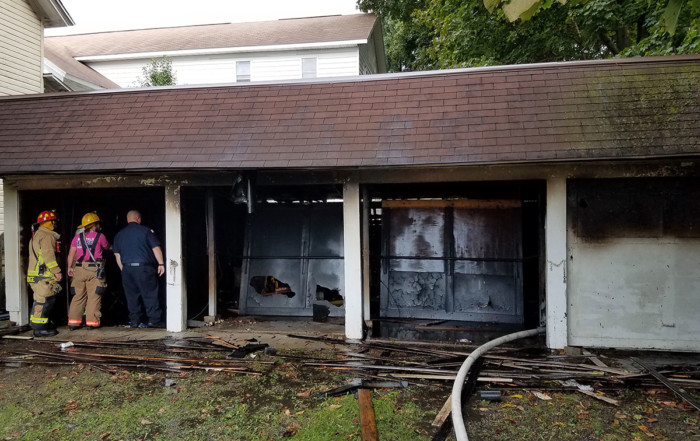 Meadville Central firefighters inspect Market St garage after fire