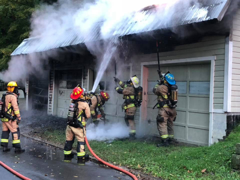 Firefighters from Meadville Central and West Mead 1 work at extinguishing a garage fire
