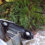 Vehicle overturned in the creek under Thurston Road