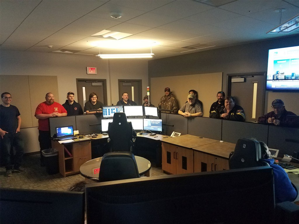 Firefighters from East Mead and West Mead 1 observe dispatchers in the 911 call center