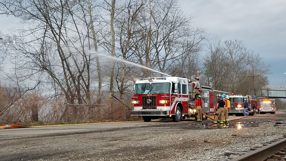 Engines from West Mead 1 and 2 are set up to draft and pump along French Creek during a drill