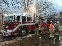 Firefighters practice pumping 28-13 during a pump relay drill