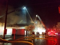 Five aerial master streams flow water at the Main St fire in Cambridge Springs