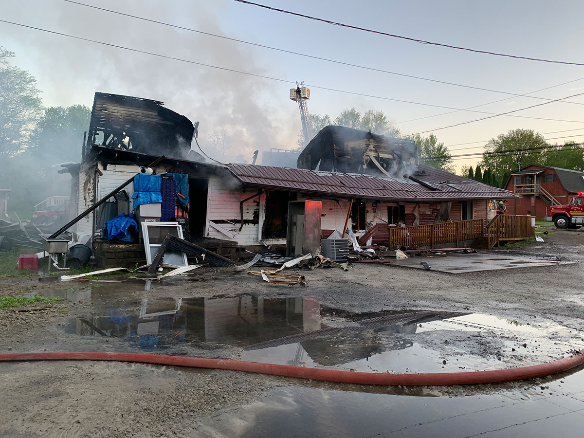 Bravo side of Eagle Nest Pizza, showing damage from an overnight fire
