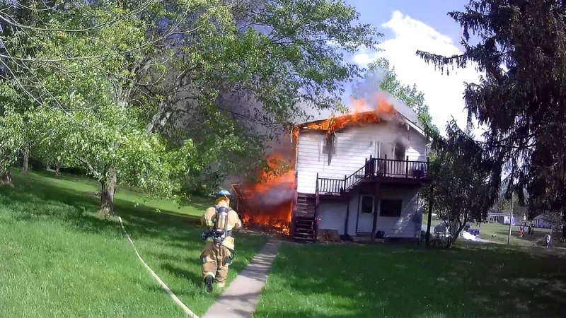 Firefighters Kyle Corey and Dallas Winckler begin a transitional attack on a Pettis Road duplex fire