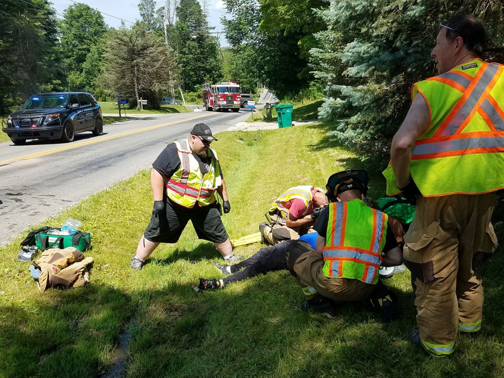 First responders provide basic life support to an injured motorist